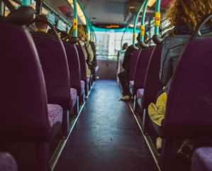 people sitting bus seats